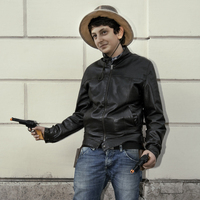 Italian cowboy with toy guns, Rome, Italy