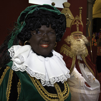 Female Black Pete with spectacles