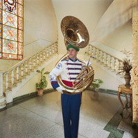 Tuba Player in Hotel Lobby